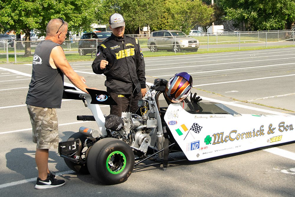 Scott & Zachary McCormick fist-bump before racing commences on Sunday morning